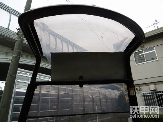 拐臂式微挖专用遮雨棚。